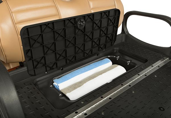 Under seat storage compartment towels