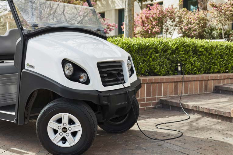 Electric campus utility vehicle with retractable charge cord