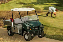 Turf utility vehicle for golf course operations and grounds maintenance