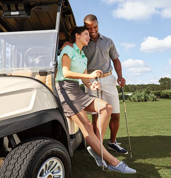 Golfers with Club Car Tempo golf cart