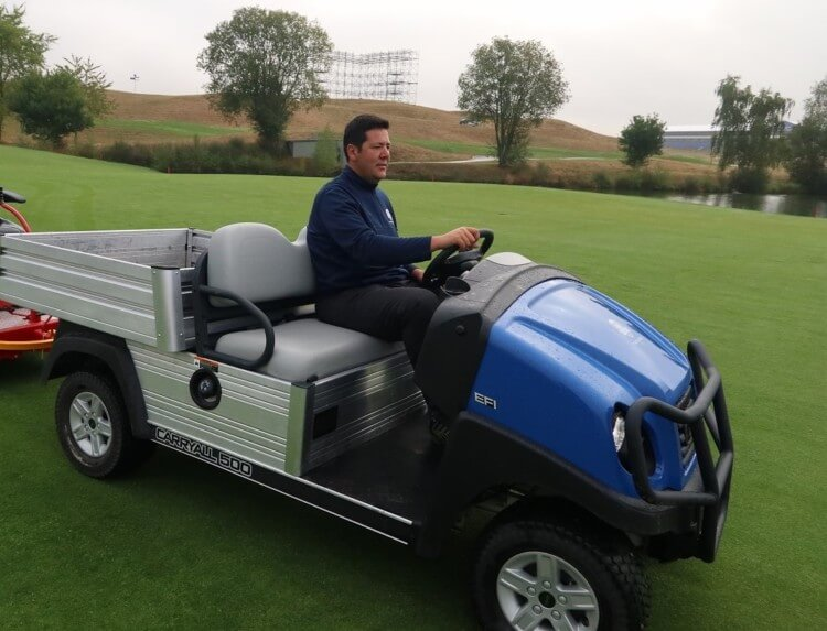 A Le Golf National groundskeeper drives a Club Car to his next destination in preparation for the 2018 Ryder Cup
