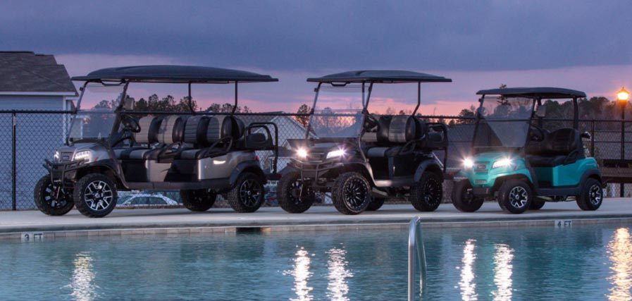 Three Onward golf carts at pool 897x427